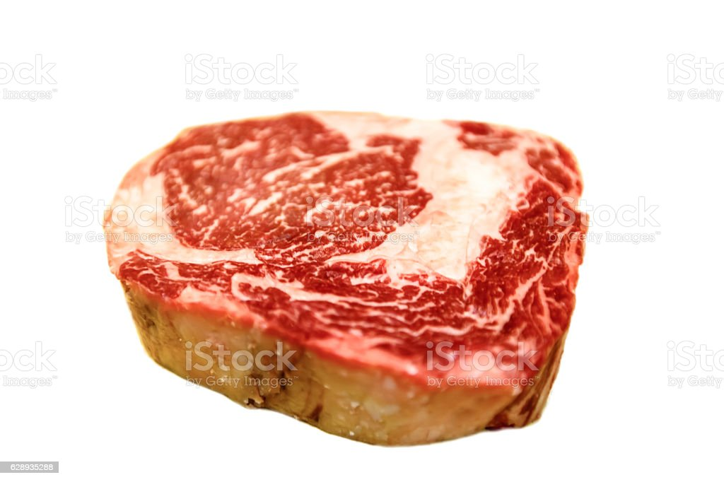 Raw ribeye beef lies on a white background. Marbled meat. stock photo