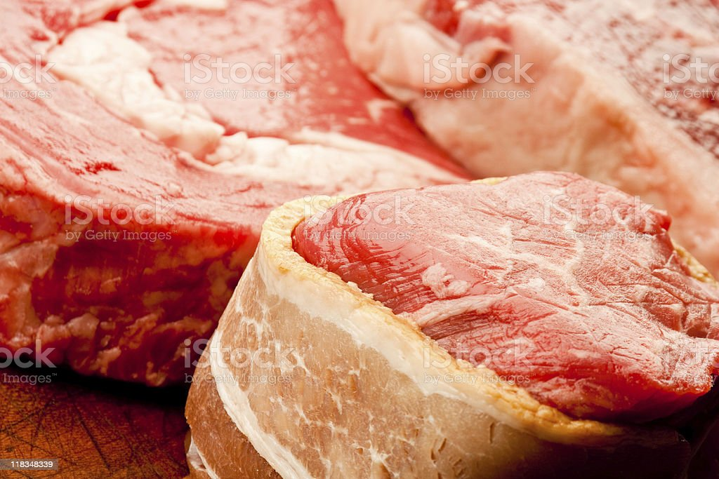 Raw Ribeye on a Wooden Cutting Board royalty-free stock photo