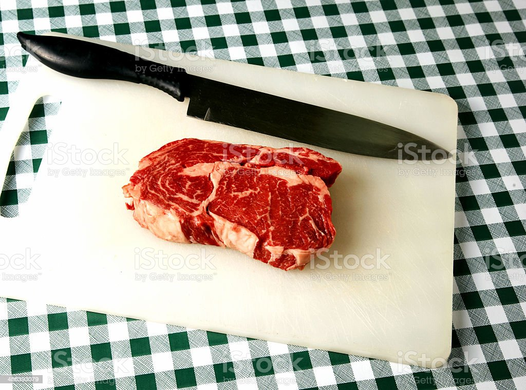 Raw rib-eye steak royalty-free stock photo