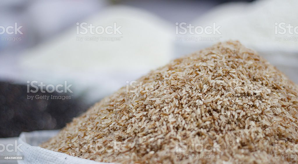 Raw rice and other grains in bags on oriental market stock photo
