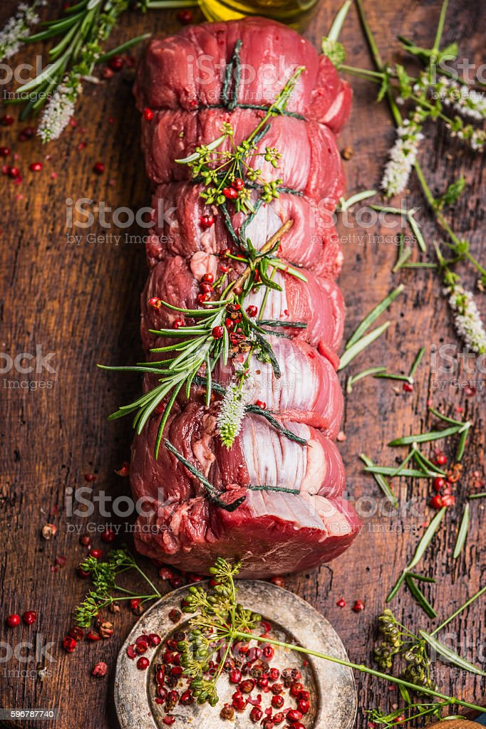 Raw roast beef  with herbs and spices, close up stock photo