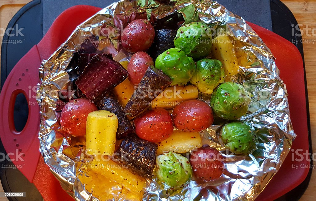 Raw Root Vegetables And Brussels Ready For Roasting stock photo