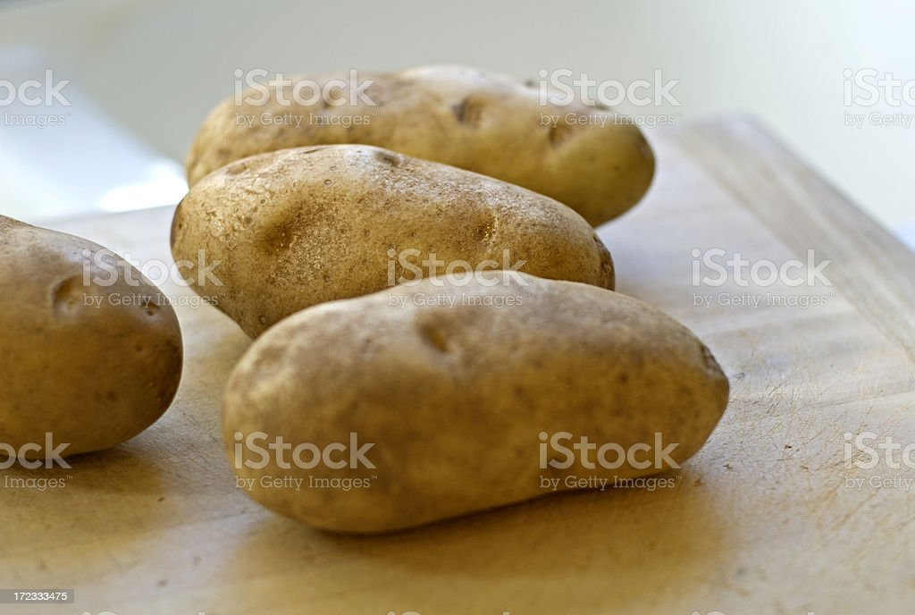 Raw Russet Baking Potatoes Root Vegetables stock photo
