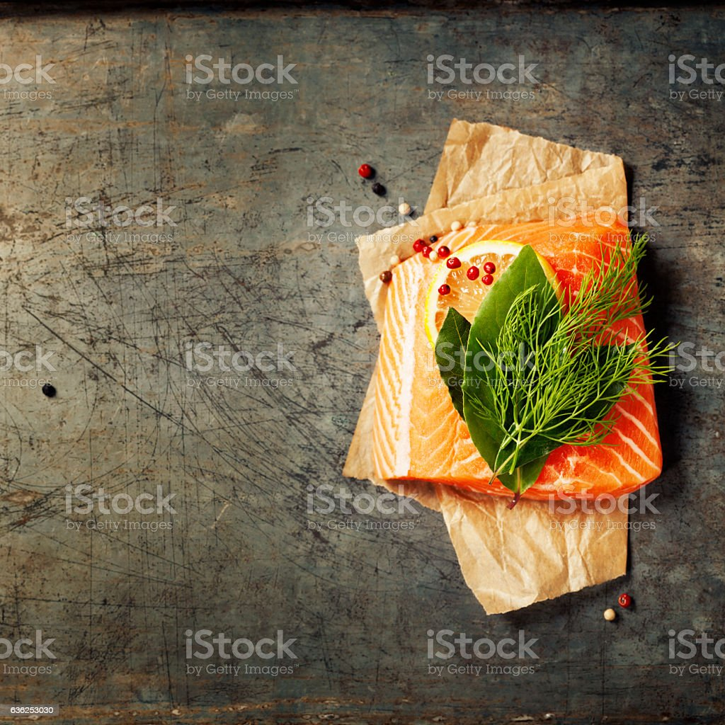 Raw salmon fillet and ingredients for cooking stock photo