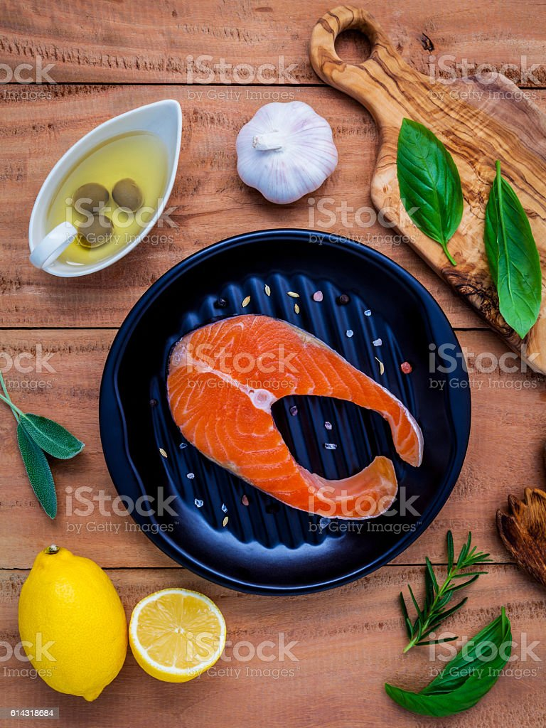 Raw salmon fillet in the black plate with ingredients . stock photo