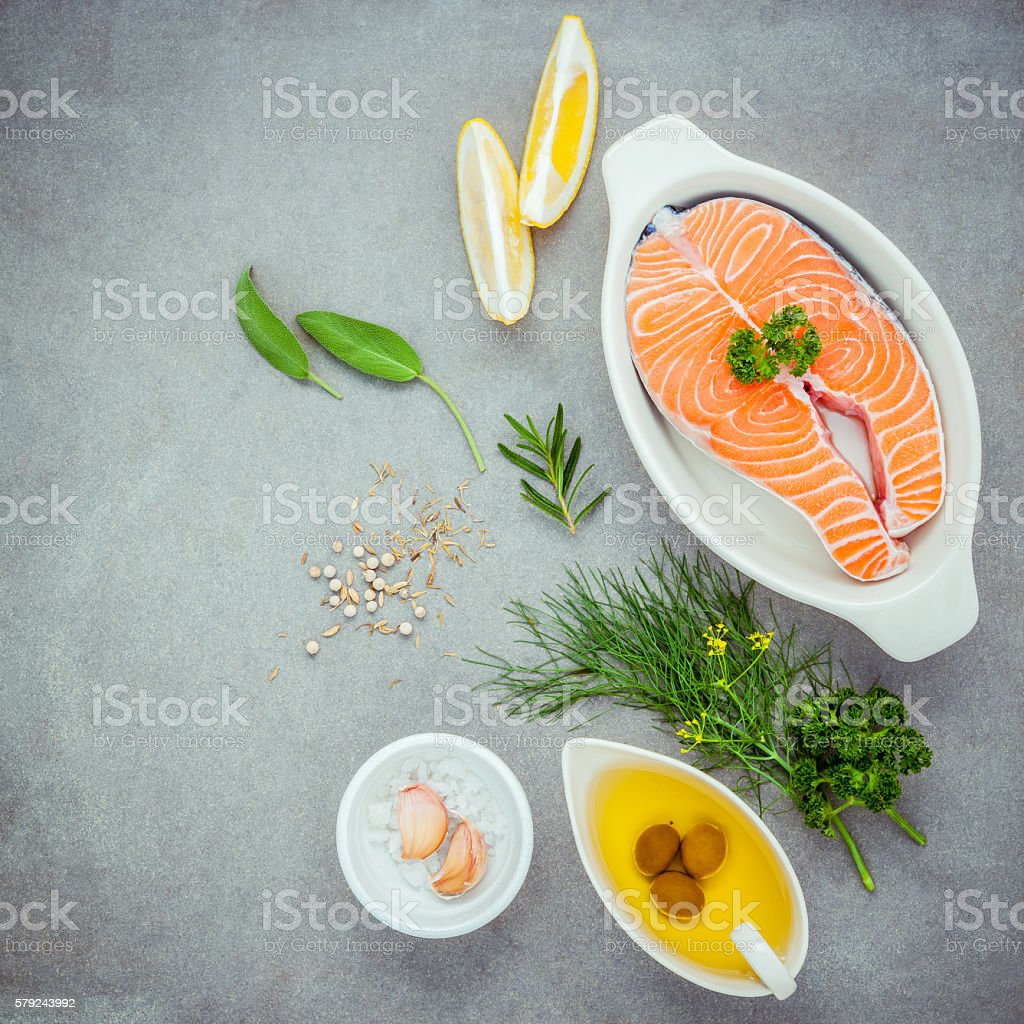 Raw salmon fillet in the white bowl with ingredients . stock photo