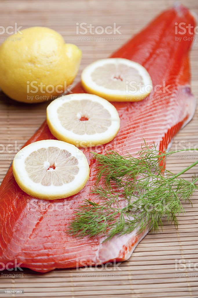 Raw Salmon Fillet with Lemons royalty-free stock photo