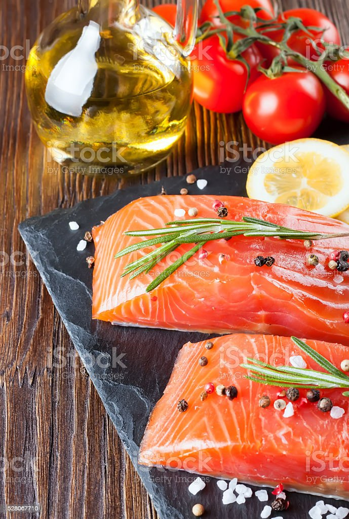 Raw salmon fillet with spices stock photo