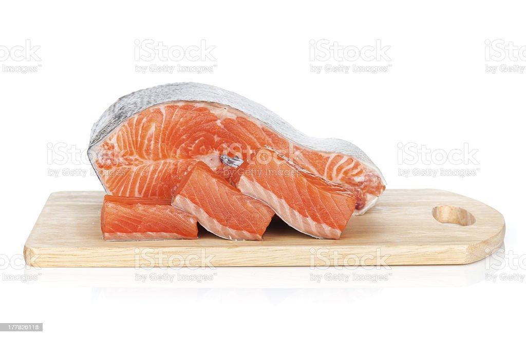 Raw salmon on cutting board royalty-free stock photo