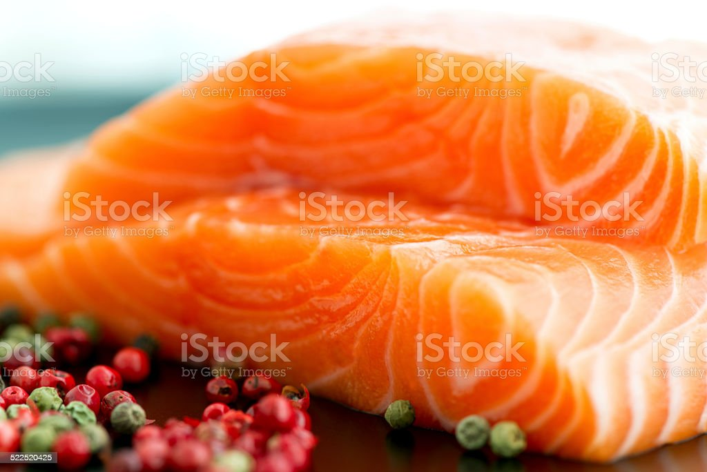 Raw salmon ready to cook close up on black surface stock photo