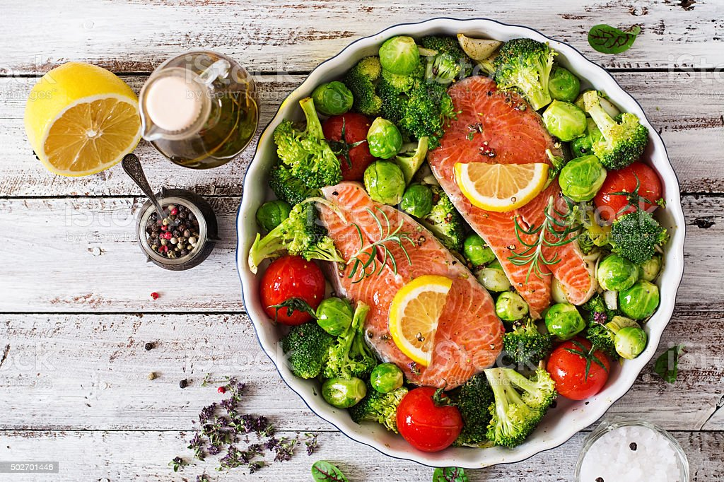 Raw salmon steak and vegetables for cooking stock photo
