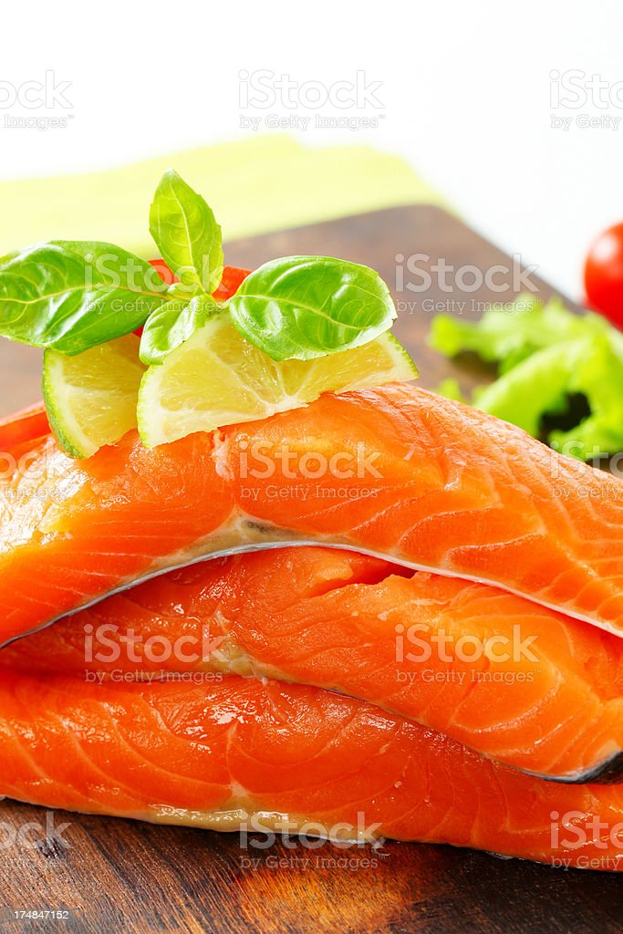 Raw salmon steaks on a wooden background royalty-free stock photo