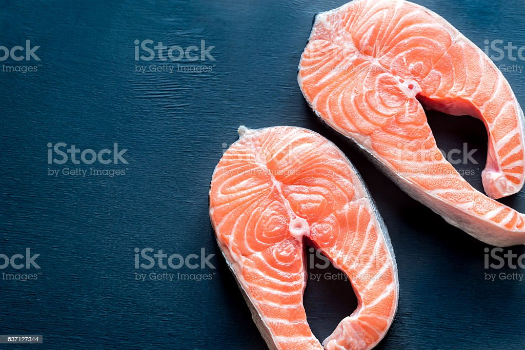 Raw salmon steaks stock photo