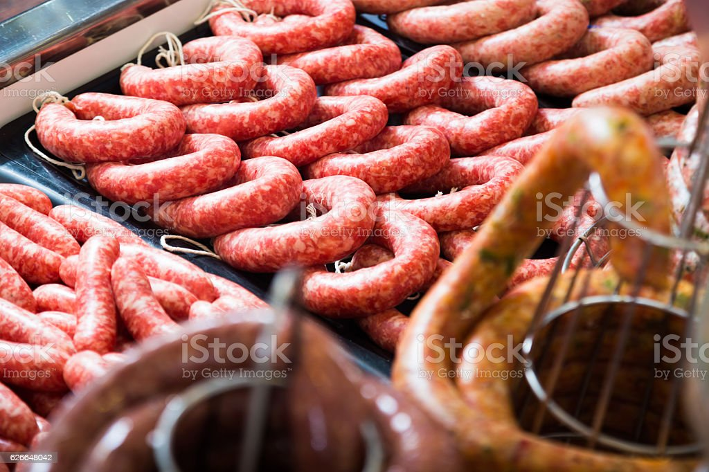raw sausage on counter stock photo