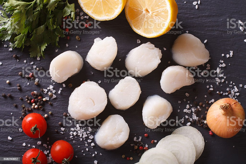 Raw scallops and ingredients for cooking close-up. horizontal stock photo