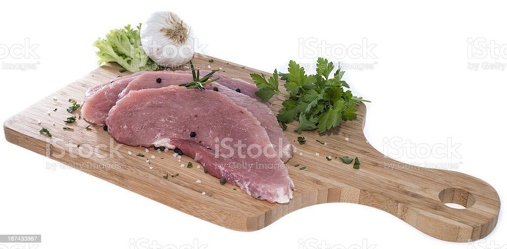 Raw Schnitzel on a Board royalty-free stock photo