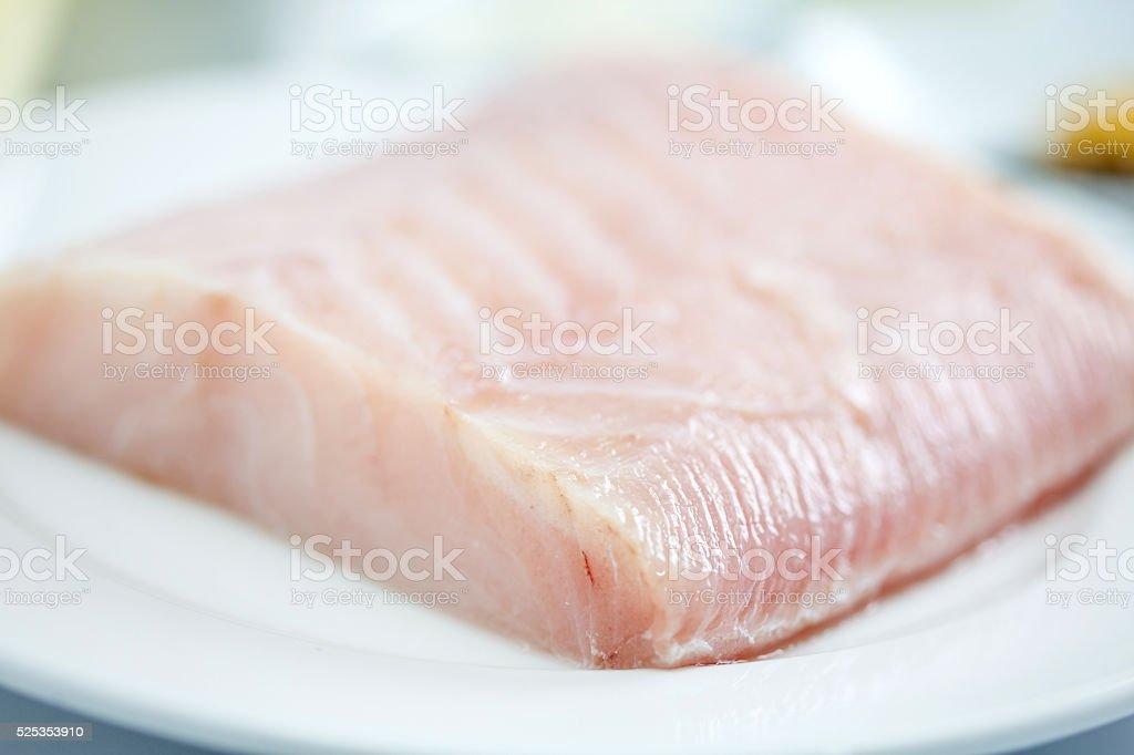 Raw sea bass fillet stock photo