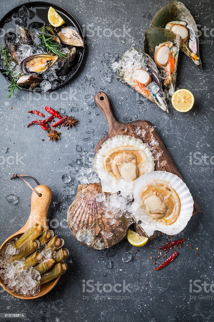 Raw seafood on dark background stock photo