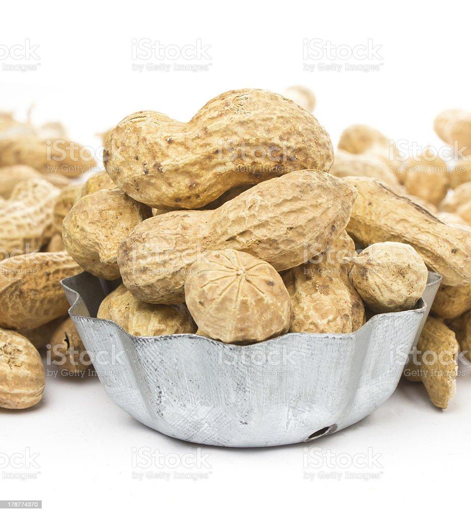 Raw shelled big peanuts on white background, closeup royalty-free stock photo