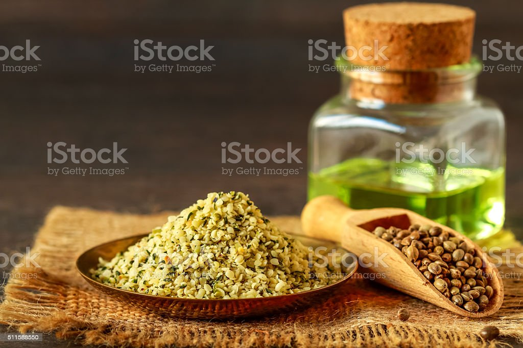 Raw shelled hemp and seeds oil stock photo