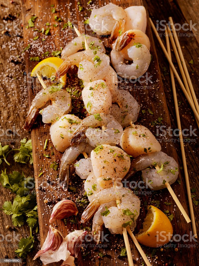 Raw Shrimp and Scallop Skewers stock photo