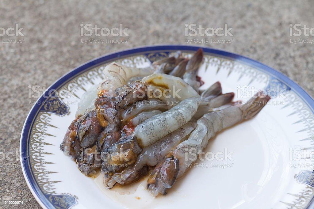 Raw shrimp in a dish stock photo