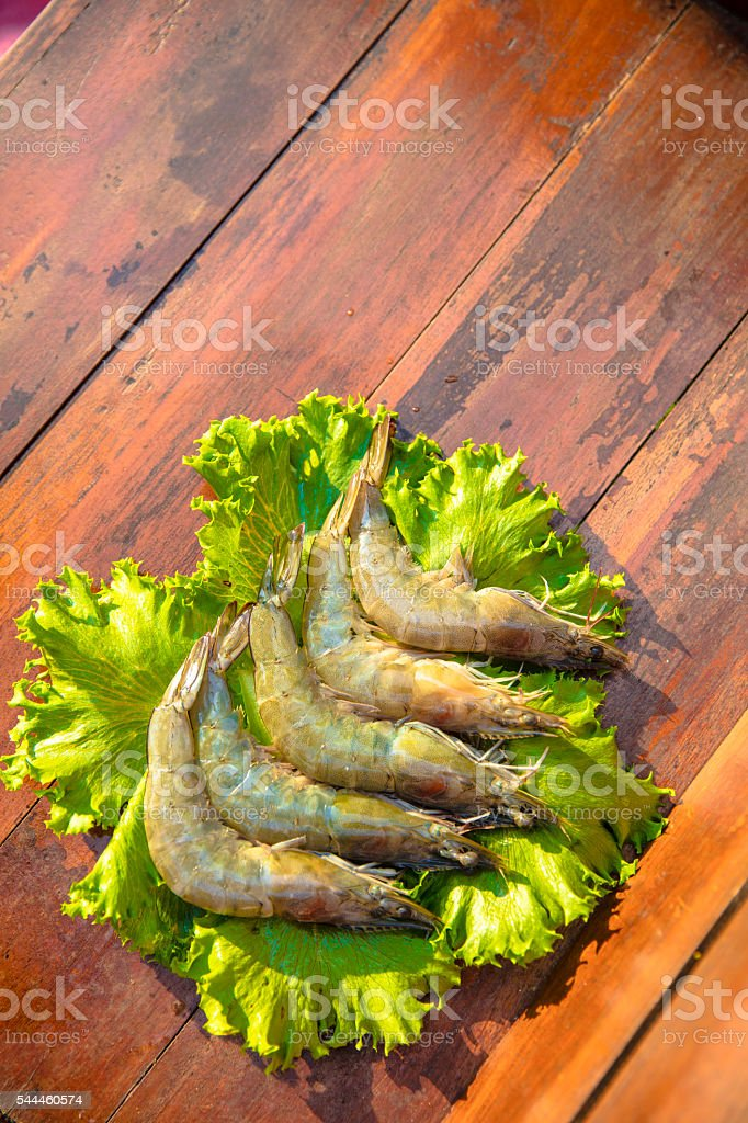 Raw shrimps and Lettuce stock photo