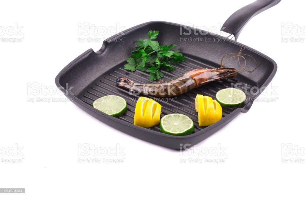 Raw shrimps on frying pan. stock photo