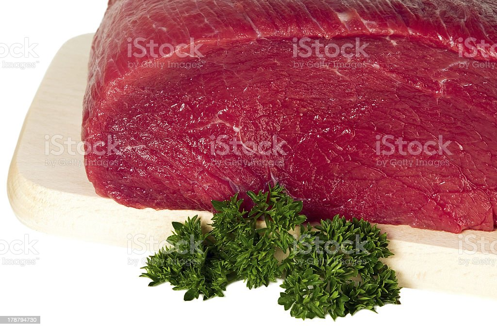 Raw sliced meat on cutting board royalty-free stock photo