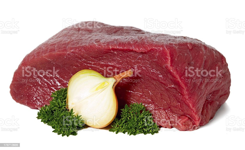 Raw sliced meat with garlic royalty-free stock photo