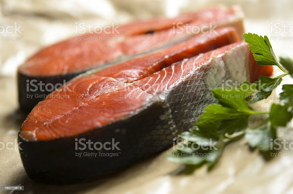 Raw Sockeye Salmon Steaks with Parsley royalty-free stock photo