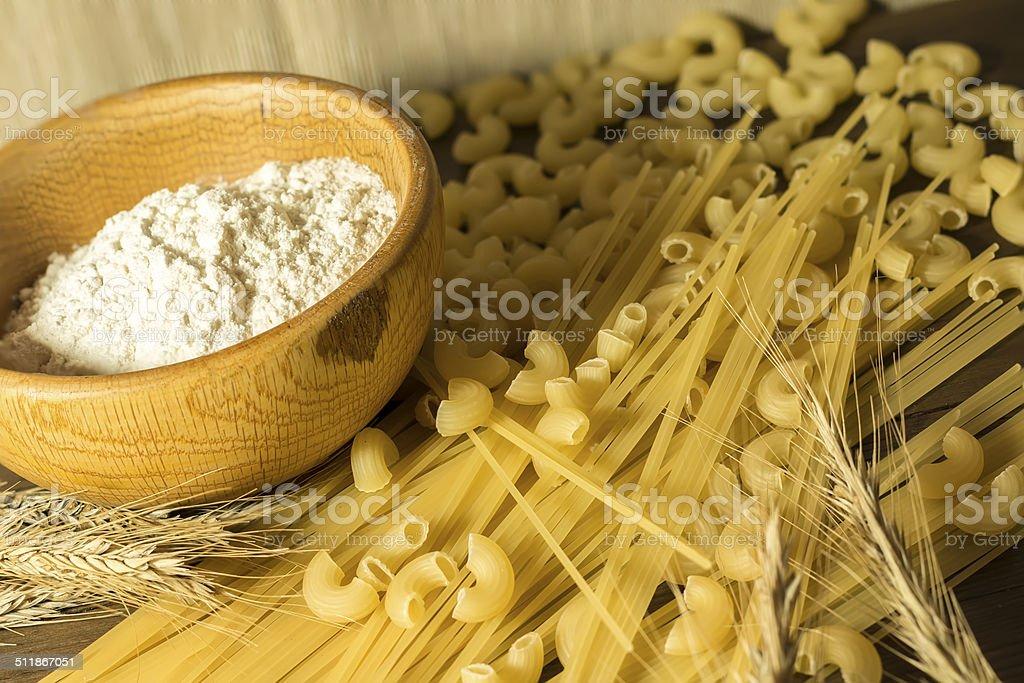 Raw spaghetti and wheat stalk stock photo