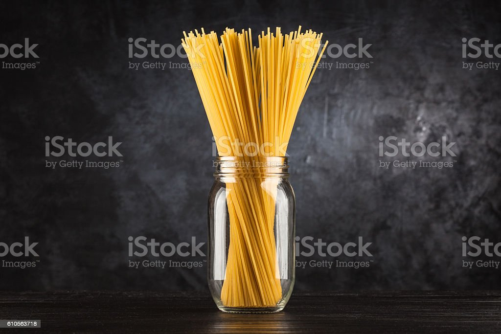 Raw spaghetti on dark background stock photo