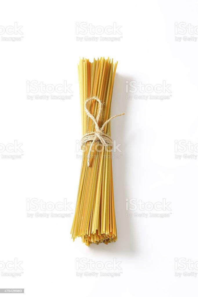 raw spaghetti stock photo