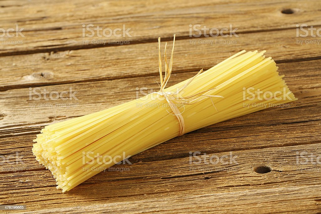 raw spaghetti stock photo