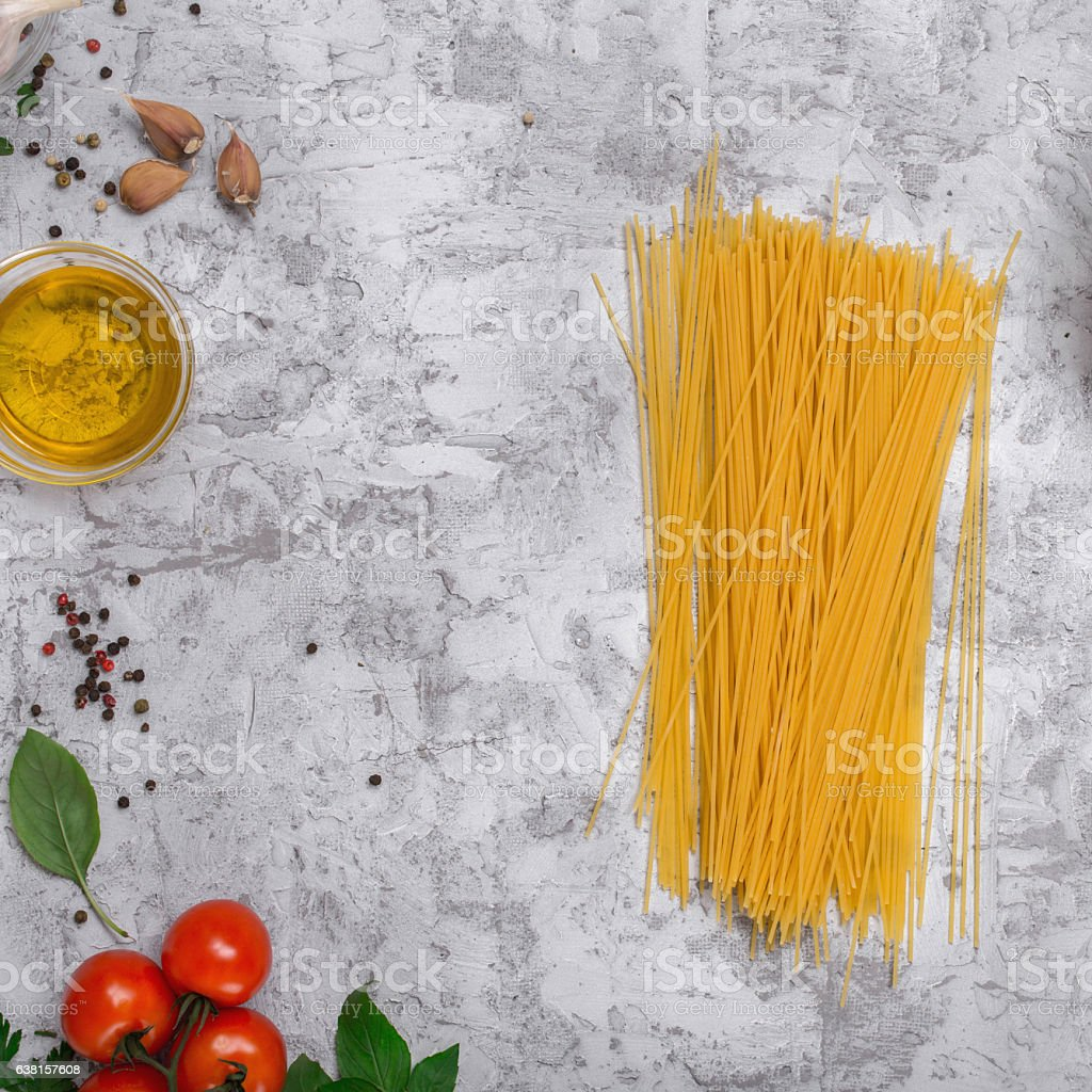 Raw spaghetti with Ingredients for cooking pasta stock photo