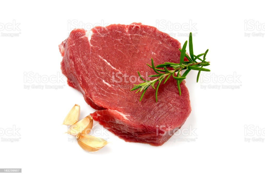 Raw steak and garlics stock photo