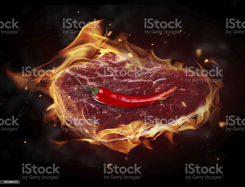 Raw steak in fire royalty-free stock photo