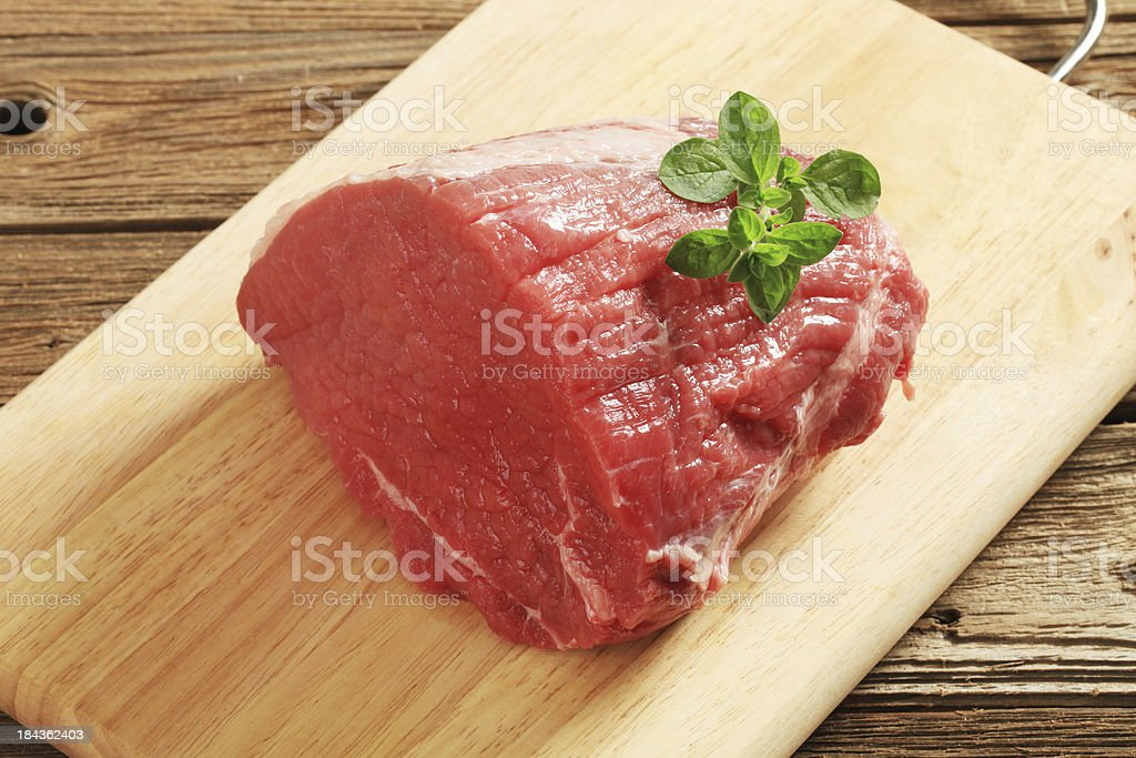 Raw steak meat on a cutting board royalty-free stock photo