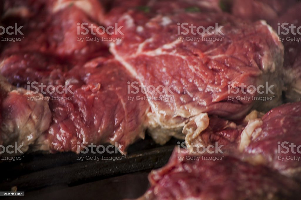 Raw steak on BBQ stock photo