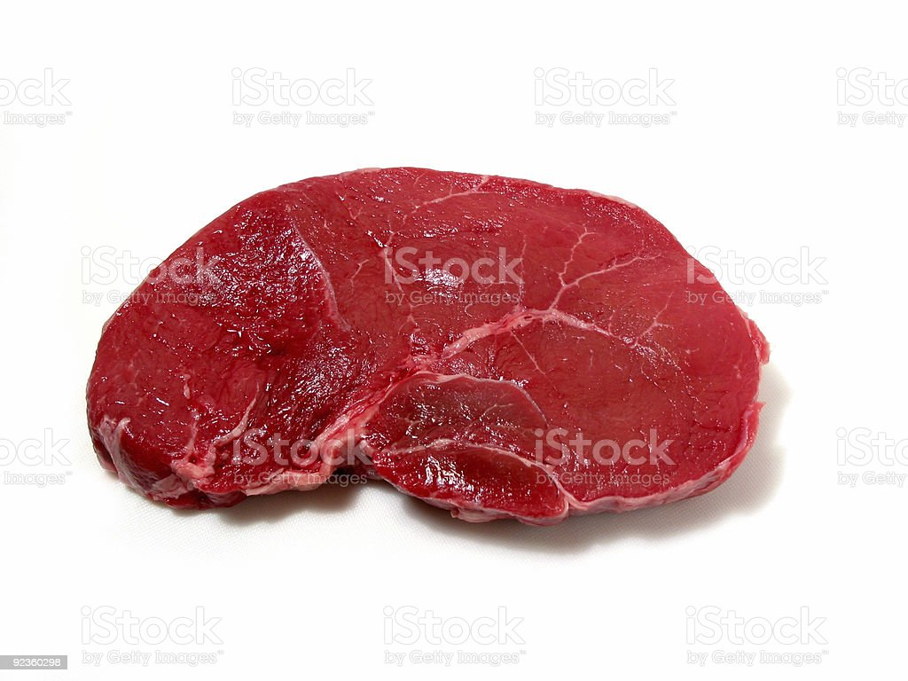 Raw steak on white background royalty-free stock photo