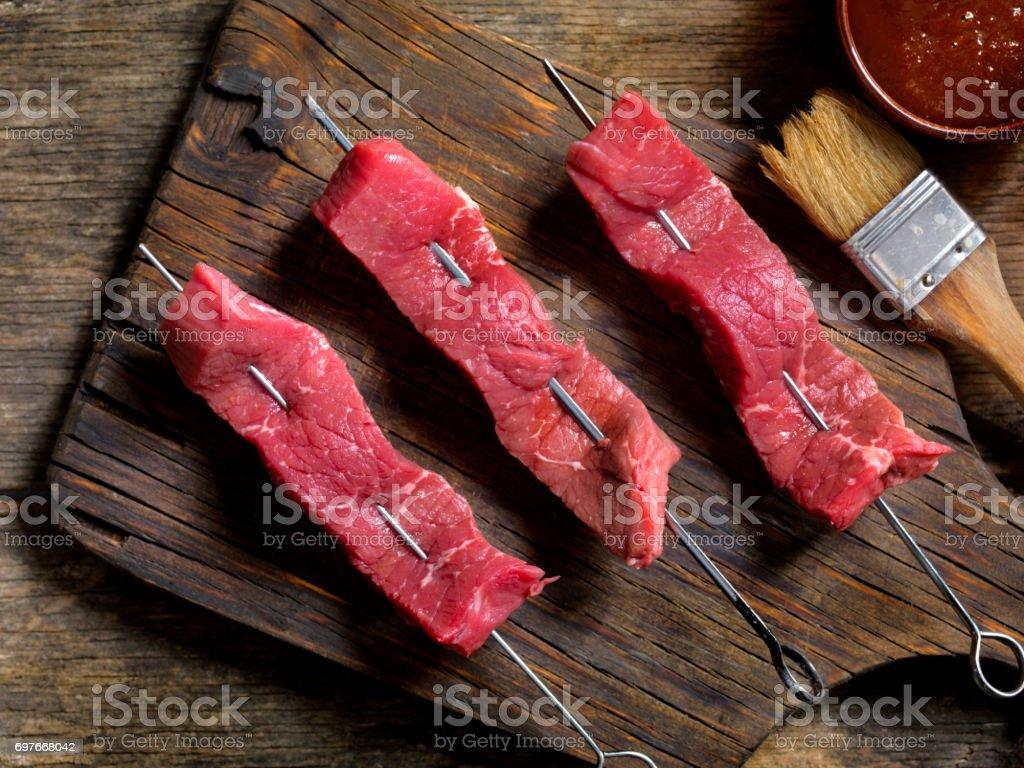 Raw Steak Skewers stock photo