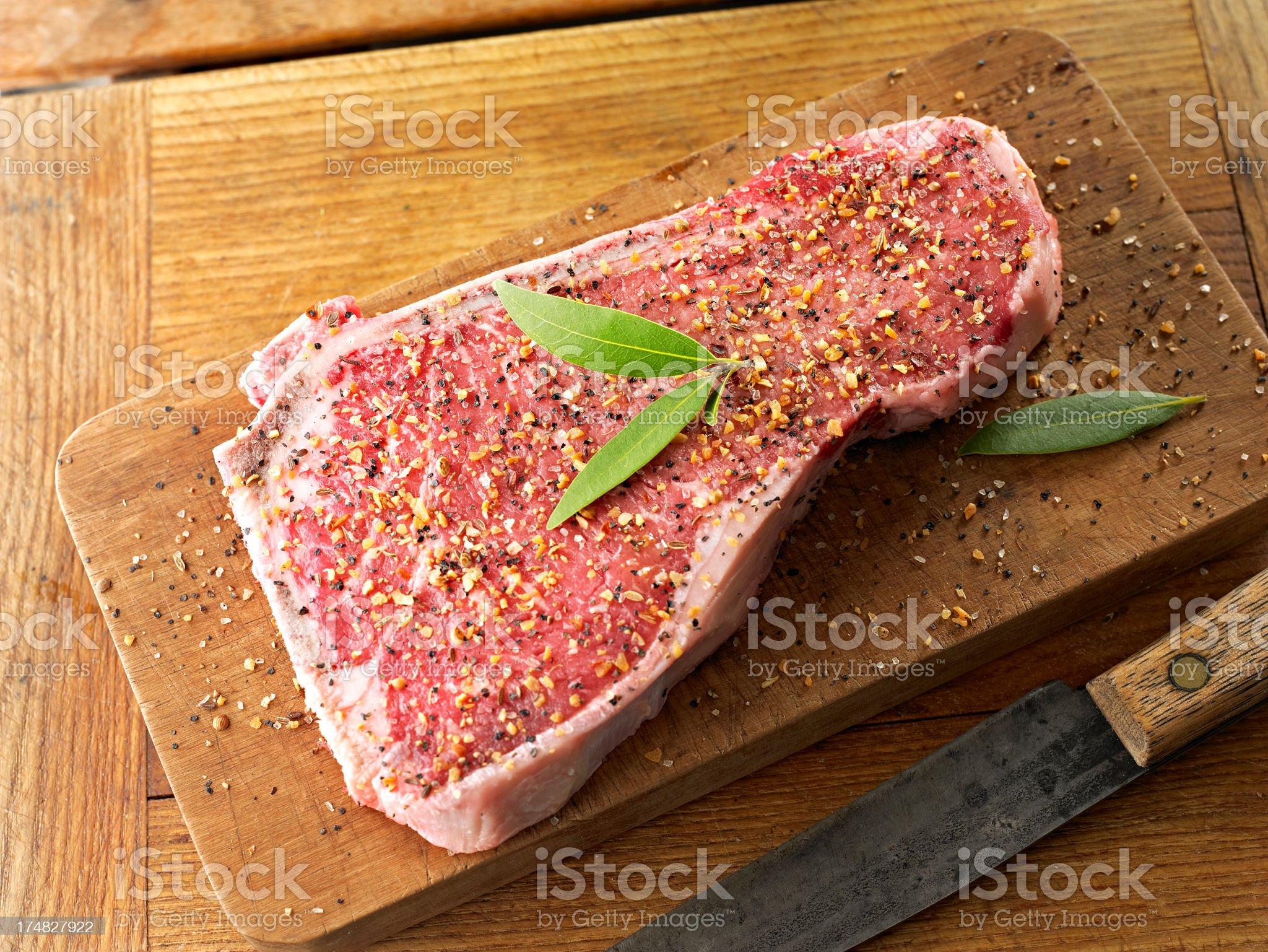 Raw Steak with Seasoning royalty-free stock photo