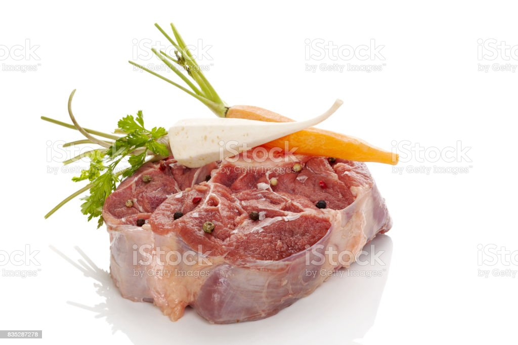Raw steak with vegetables isolated. stock photo