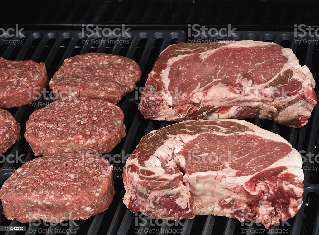 Raw steaks and Hamburguers royalty-free stock photo