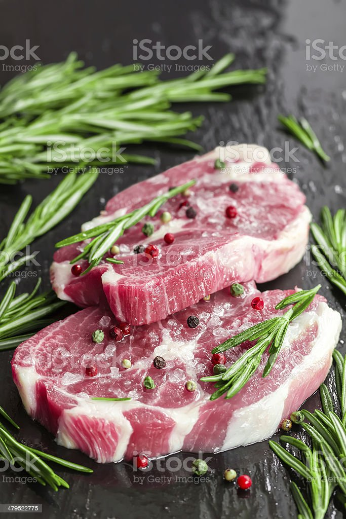 Raw steaks stock photo