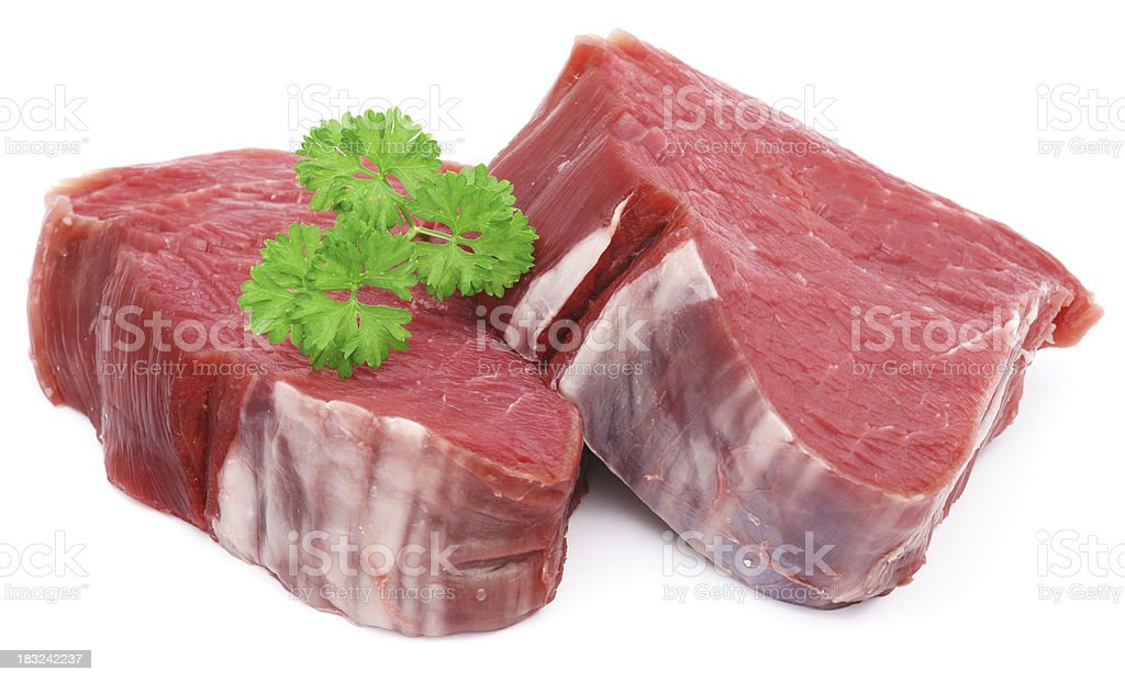 Raw steaks with parsley isolated on white royalty-free stock photo