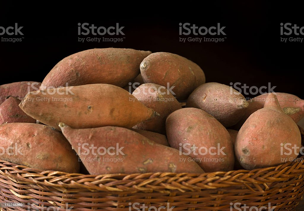 Raw Sweet Potatoes Yam in Basket, Organic Root Vegetable royalty-free stock photo