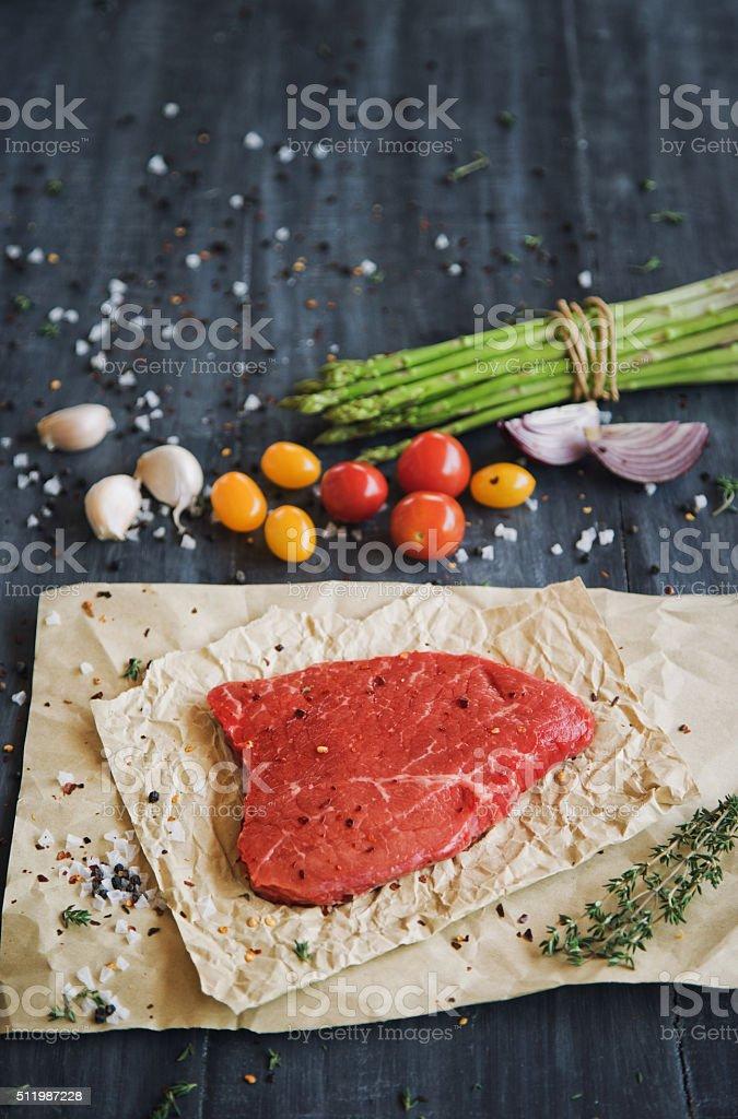 Raw tenderloin steak with veggies stock photo