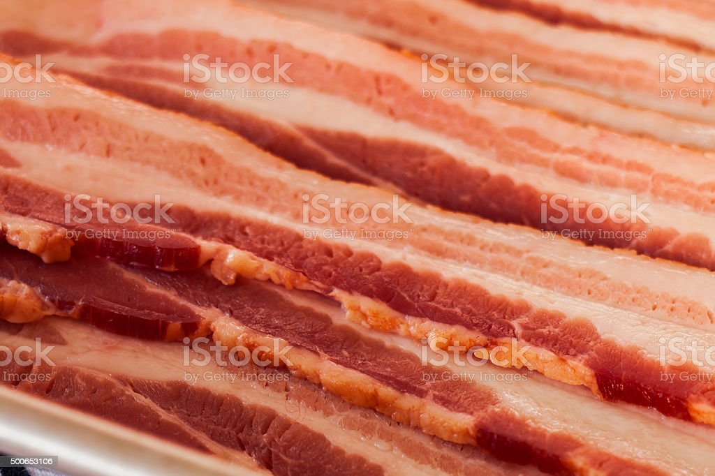 Raw thick cut bacon slices stock photo